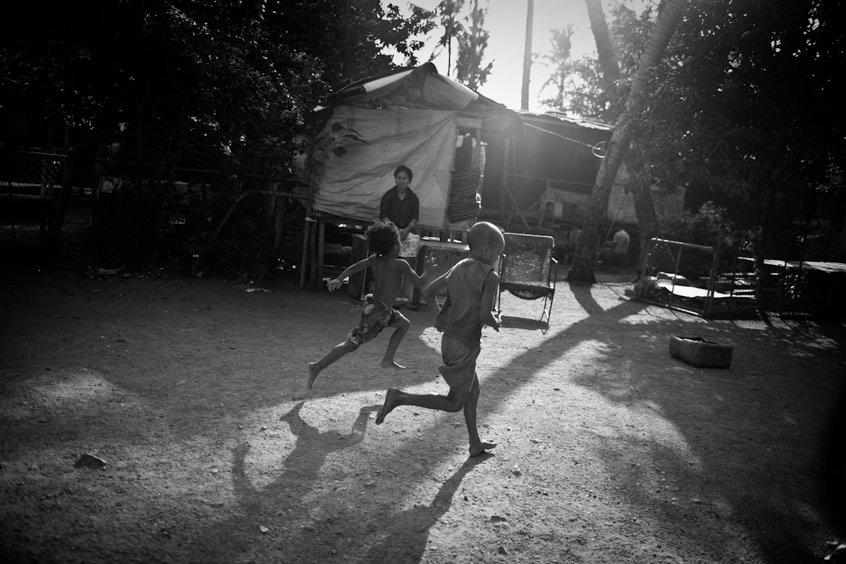 Children run through Wanigela Settlement outside Port Moresby, an area known well for it's outbreaks of cholera.