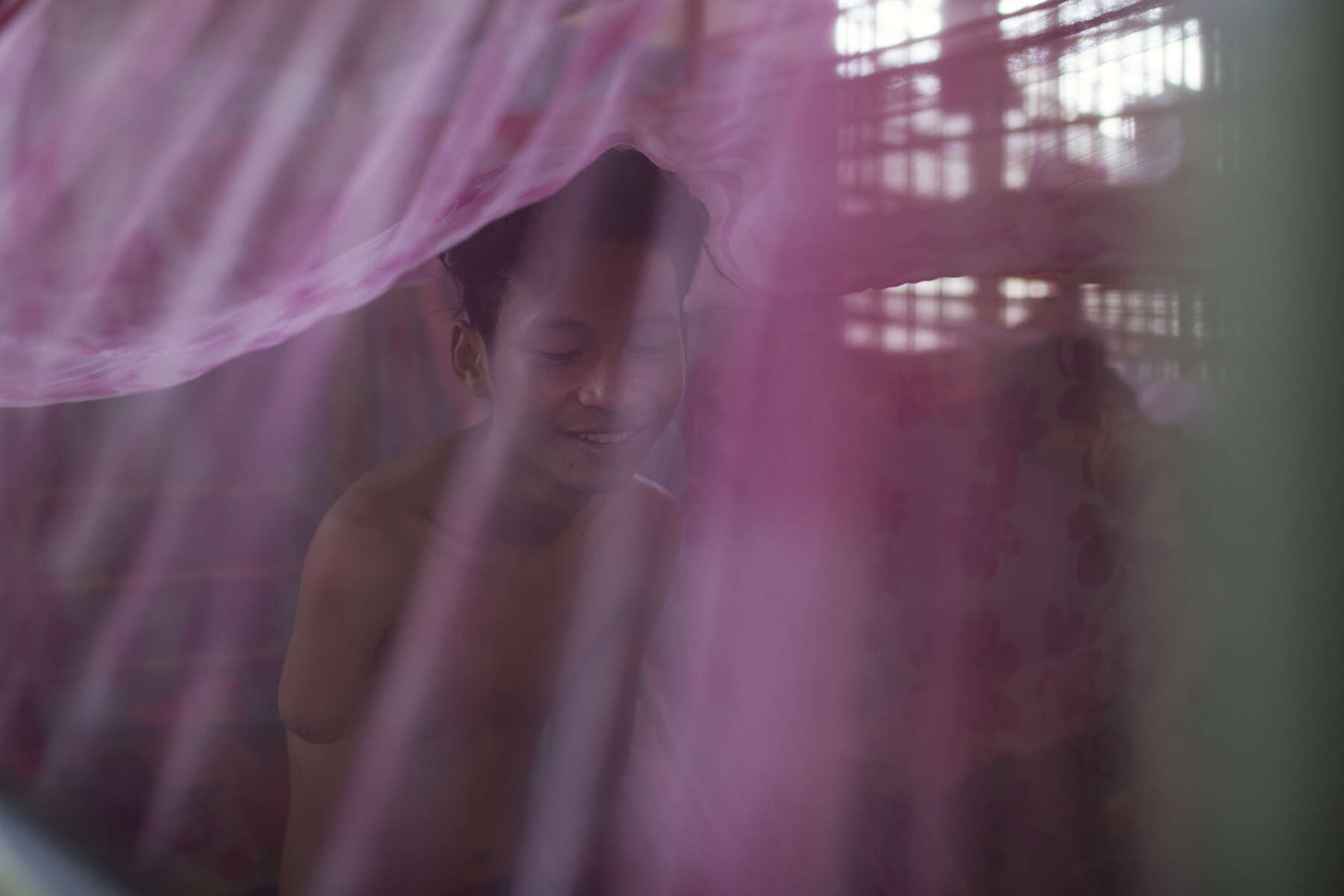 A young man wakes up at the hostel on site at Villa Maria. Villa Maria also known as Yodifee is the next step for a lot of the LaValla graduates, providing opportunities for secondary and tertiary education while living at the centre or in one of their home. Marist Solidarity Cambodia seeks to empower young Cambodians with disabilities through education and training, leading to employment and self sufficiency.