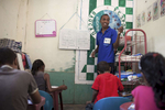 Elvin Oliveira a volunteer teacher at Ponta Leste runs an English class in the afternoon for local children.