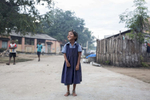 A young school student walks around Mangmanuthu  Village in the early morning. The Marist Brothers have a High School in the village. The school is situated in a remote area of Tamil Nadu Province, India.  The Marist Brothers opened the school in 2005 and has 750 students classes 6-12.