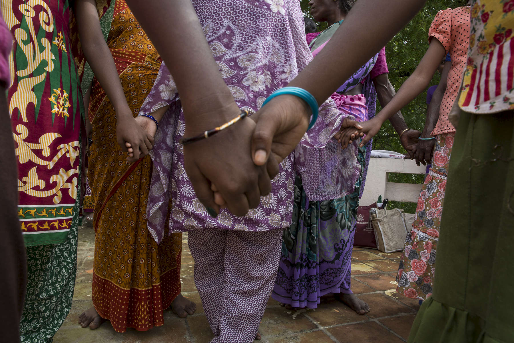 Families attend a Rainbow Project gathering. The Brothers had seen that the families of people who had HIV had become outcasts from their communities, because people did not understand the mechanisms around AIDS and HIV. The children became ostracised from school and people were unable to either keep their jobs or because of the illness were unable to maintain a steady job so they had no income.