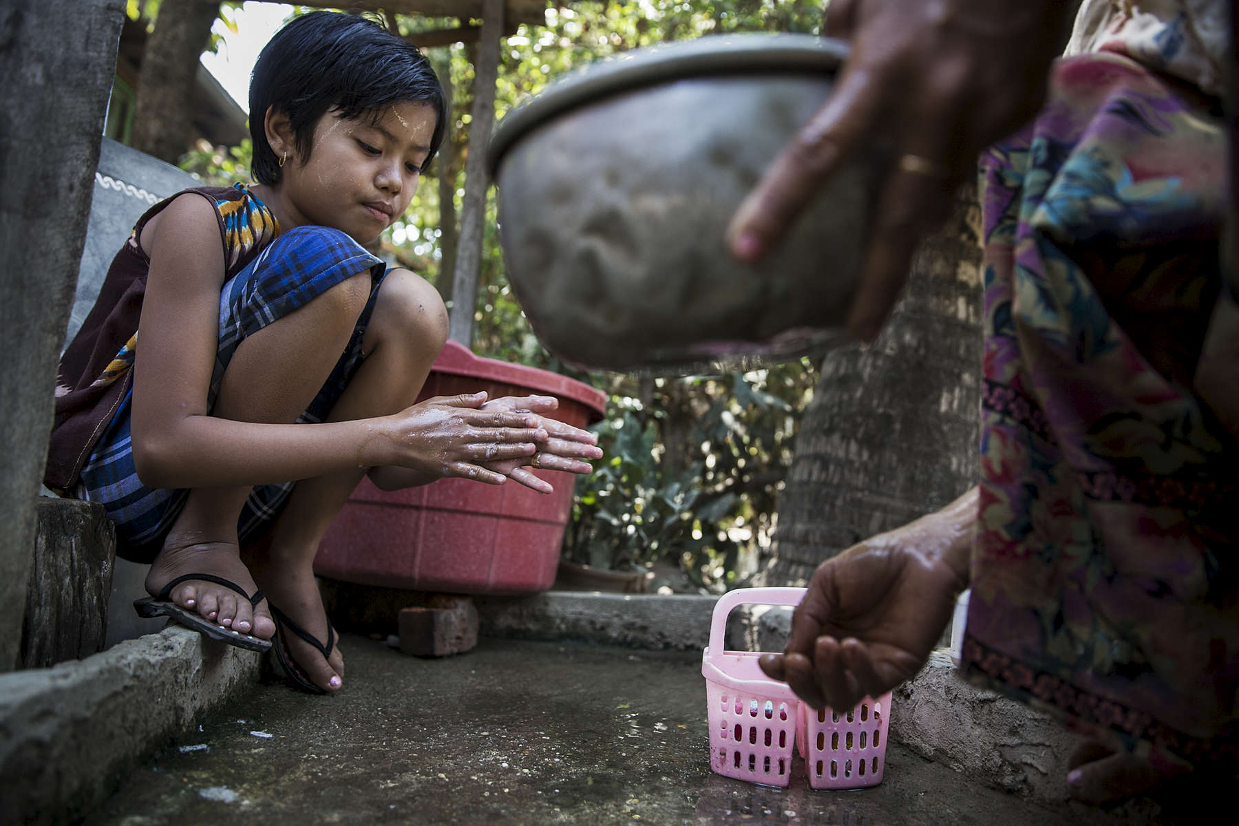 Zin Yun Su Su Hlaing washes her hands after coming home from school in Kwe Ma village. The Australian Red Cross in partnership with Myanmar Red Cross has been carrying out a Community Based Health & Resilience project in Kwe Ma and a number of other villages in central Myanmar. The CBHR project is working to educate and ensure sustainable changes to water and sanitation practices in these communities. A major part of the project is community education. Red Cross Volunteers from each community regularly run awareness campaigns throughout their village and regularly visit school where they use songs and poems to educate children about water and sanitation, first aid and disaster risk reduction.