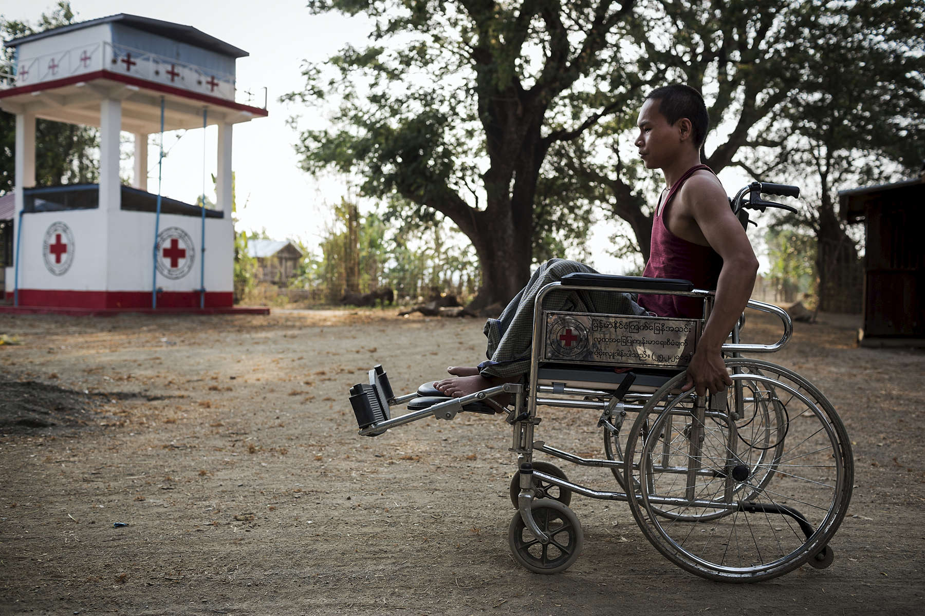 In the late afternoon as it cools down Aung Myo Oo, 22 years old, pushes himself through Yin Ywa village to go and chat with his friends. Two years ago in a farming accident Aung Myo Oo become paralysed, as part of the current project he was provided a wheel chair so he can move around independantly. The Australian Red Cross in partnership with Myanmar Red Cross has been carrying out a Community Based Health & Resilience project in Yin Ywa and a number of other villages in central Myanmar, an area known as the Dry Zone. . A major part of the project is community education. After ensuring quality community education, the project then install physical hardware, taps, tanks, toilets etc. When considering where to place communal water points the project consults the community to identify vulnerable member such as the elderly and disabled who may struggle to travel distances with heavy loads of water.