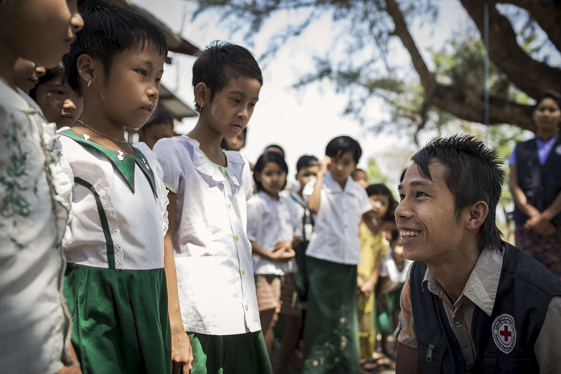 RCV Khin Maung Thet  visits Kwe Ma primary school to present educational songs, games and poems to the children about water and sanitation. Australian Red Cross has been working with Myanmar Red Cross to carry out a Community Based Health & Resilience project in the area. CBHR seeks to educate and ensure sustainable changes to water and sanitation practices in the villages where they are working. A major part of the project is community education. Red Cross Volunteers from each community regularly run awareness campaigns throughout their village and regularly visit school where they use songs and poems to educate children about water and sanitation, first aid and disaster risk reduction.