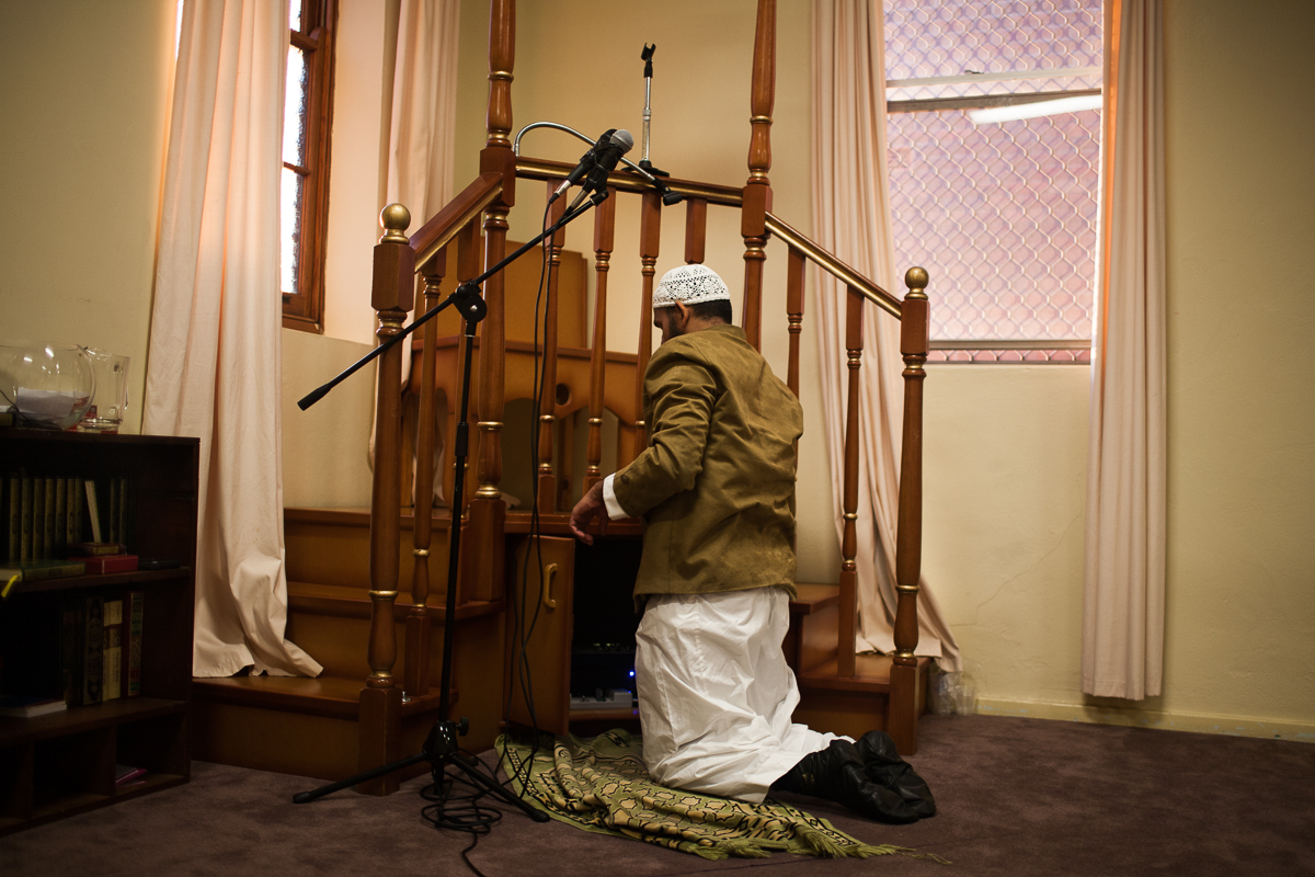 A member of the Muslim community sets up the microphone and speakers before midday prayer.