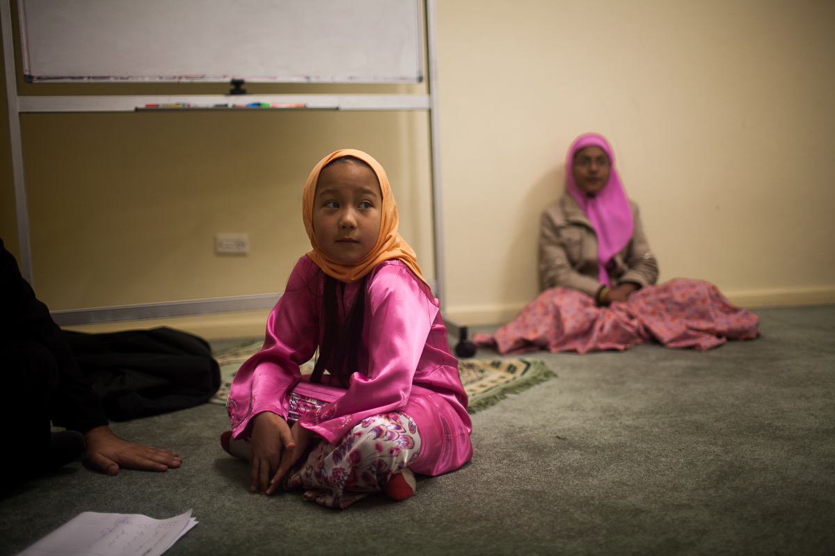 On the weekend Muslim children attend Qu'ran classes at the Mosque where they practice reciting verses.