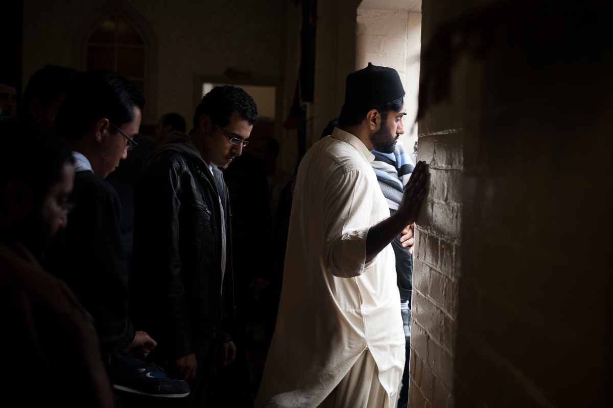 A Pakistani man leaves the hall neighbouring the mosque after Friday prayers.