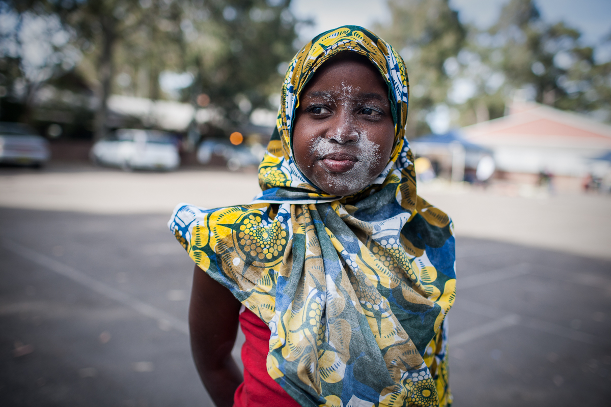A girl's face is covered in flour after playing a game organised during the Eid celebrations. Eid is an important religious holiday celebrated by Muslims worldwide that marks the end of Ramadan, the Islamic holy month of fasting.