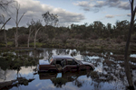 A recently crashed car remains in water after careering off the main road from Northam to Perth. Sami Shah and his family migrated from Pakistan to Australia one year ago after receiving death threats for his work at a political journalist, the family now live in Northam a small country town of 7000 people approximately 100 kilometres from Perth the capital of Western Australia. 08/17/2013  Credit : Conor Ashleigh for the International Herald Tribune.