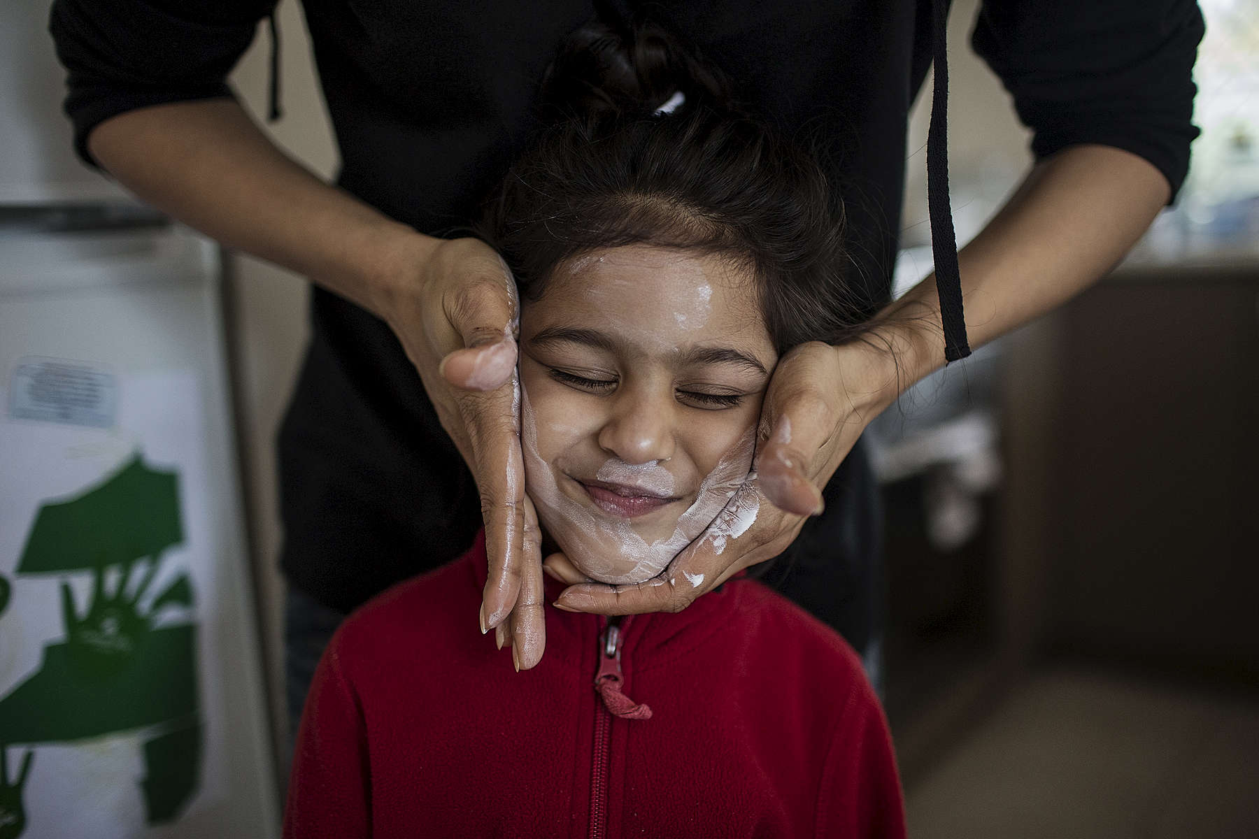 Ishma Alvi applies sunscreen to her daughters face before going out to a park. Sami Shah, his wife Ishma Alvi and daughter Anya migrated from Pakistan to Australia one year ago after receiving death threats for his work at a political journalist. The family now live in Northam a small country town of 7000 people approximately 100 kilometres from Perth the capital of Western Australia. 08/17/2013  Credit : Conor Ashleigh for the International Herald Tribune.