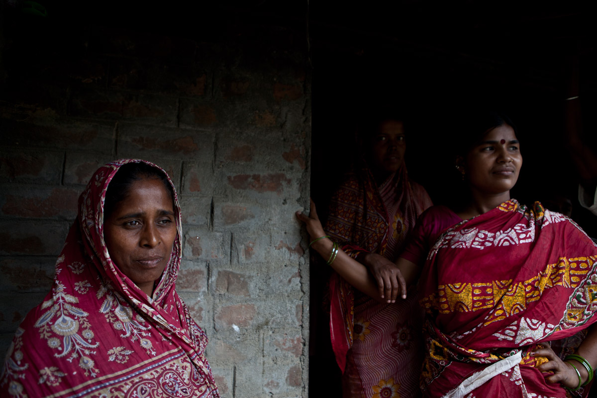 Women who receive support from SOS Kolkata's Self Help Group stand outside their animal pen, which was built as part of the project.