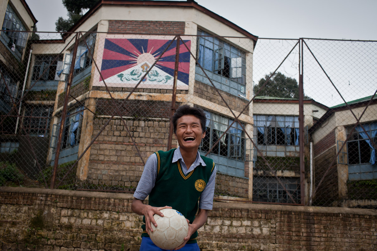 A boy prepares to take his serve during a game of volleyball at the Tibetan Children's Village.