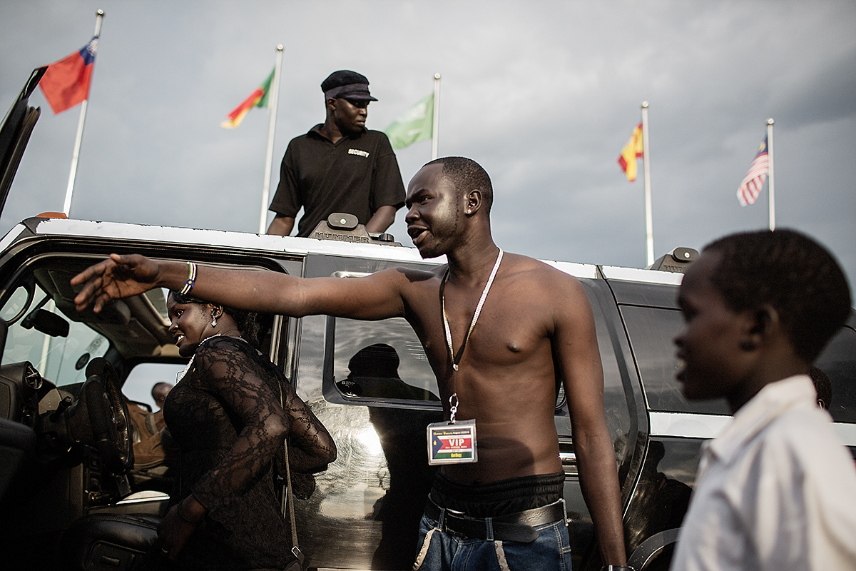 A young man gives people a tour of his hummer in the late afternoon once the anniversary celebrations come to a close.