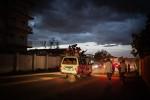 A football team aboard a mini van celebrate through Juba in the early evening.