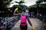 Winnie Natasha celebrates after winning her kickboxing match at the the International Kickboxing Challenge in Juba. Winnie is 21 years old and currently studying law at Juba University.