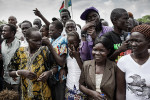 A crowd attending the second independence anniversary of South Sudan scramble to receive water during the  celebrations.