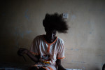Lucia Jon Deng17 years of age brushes her hair. Lucia is in grade 8 and hopes to become  a doctor one day.