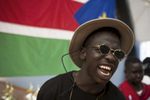 Maluer Malou (2.5 years after previous picture was taken) dances along to a song at the annual National South Sudanese basketball competition which was held in Sydney in 2014.