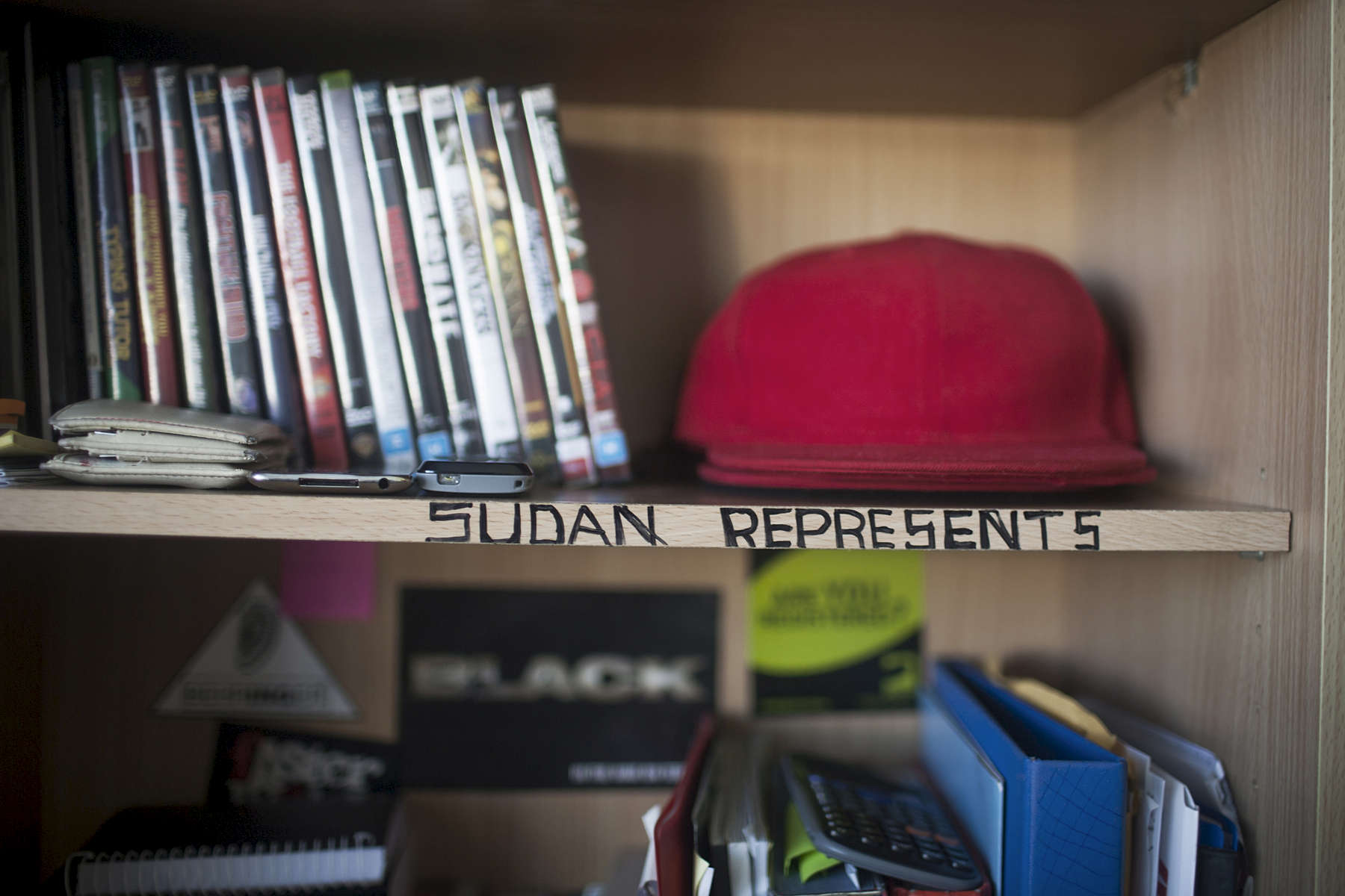 Apa Manyang has written 'Sudan Represents' along the edge of his desk at home in Newcastle, 2010.  Apa commonly known by his musical name 'Willo da Kid' arrived in Australia with his Mother and 5 siblings in 2004. Apa is now studying music at Australian Institute of Music and collaborates with a range of artists.