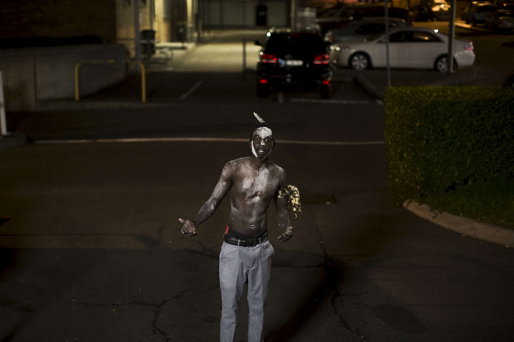 On July 9th 2015 in Western Sydney suburb of Blacktown young Australian South Sudanese men prepare to perform a traditional Dinka Agaar dance. They use talcum powder to cover their skin, in South Sudan this was traditionally done with ash and feathers from native birds would also be used to adorn the body and head, however in Australia chicken feathers are utilized as a substitute.