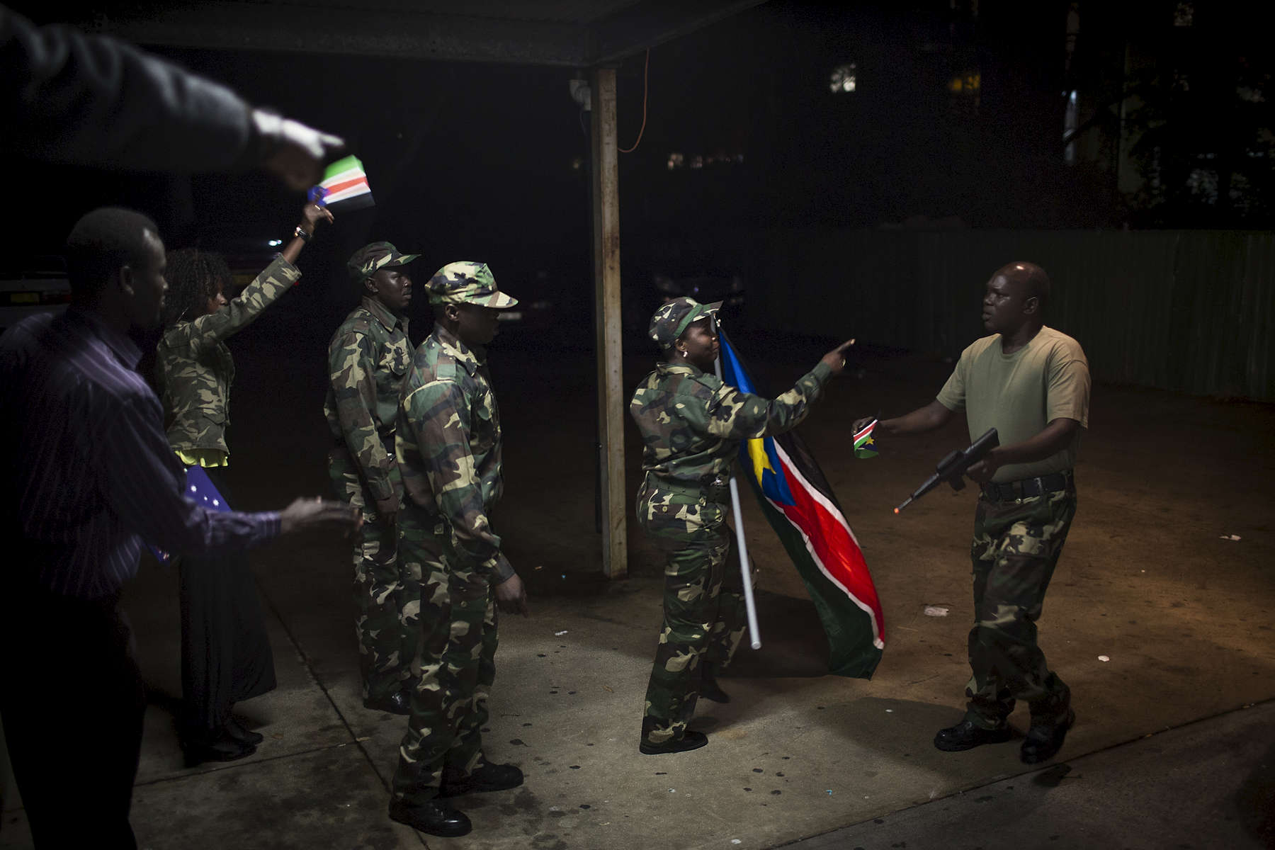 Dressed in army uniforms at a community hall in Western Sydney in 2013, supporters of the Sudan People's Liberation Army (SPLA) practice marching before returning inside the hall to perform at an event marking the 30th anniversary of the SPLA. The SPLA was founded as a guerrilla movement in 1983 and led by John Garang de Mabior. Since South Sudan's independence in 2011 the SPLA has become divided and conflict has ensued with major factions aligning with Dinka President Kiir and many others following Nuer former Vice-President Machar who now leads the SPLA-IO (in opposition).  After a 18-month war that has ravaged the world's newest country, the two leaders Kiir and Machar signed  a peace deal on August 27th 2015.
