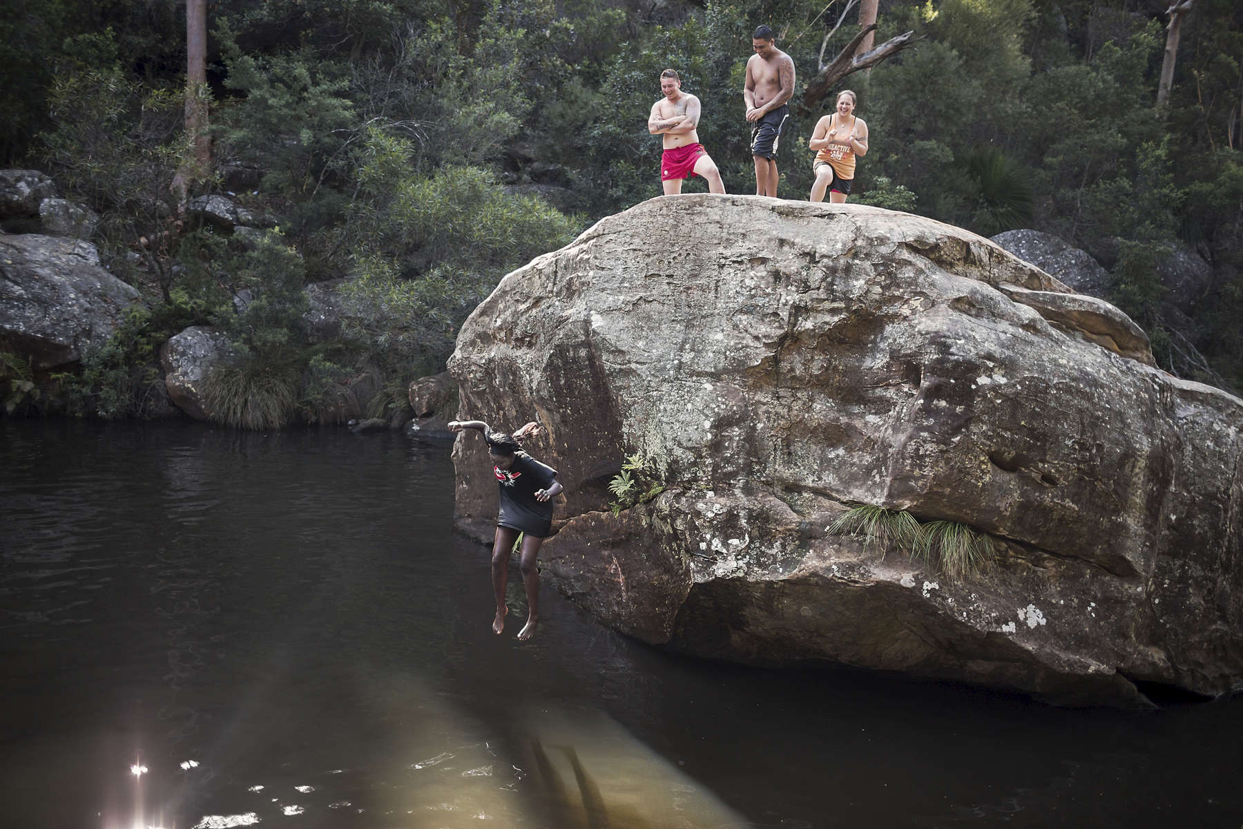 Outside Sydney at Jellybean pool in the Blue Mountains National Park, Achingol Mayom falls into the water after being pushed off a popular jump rock for taking too long. Achingol was part of a group of young Australian South Sudanese who participated in a cell phone photography project the photographer crowd funded to run in January 2015.