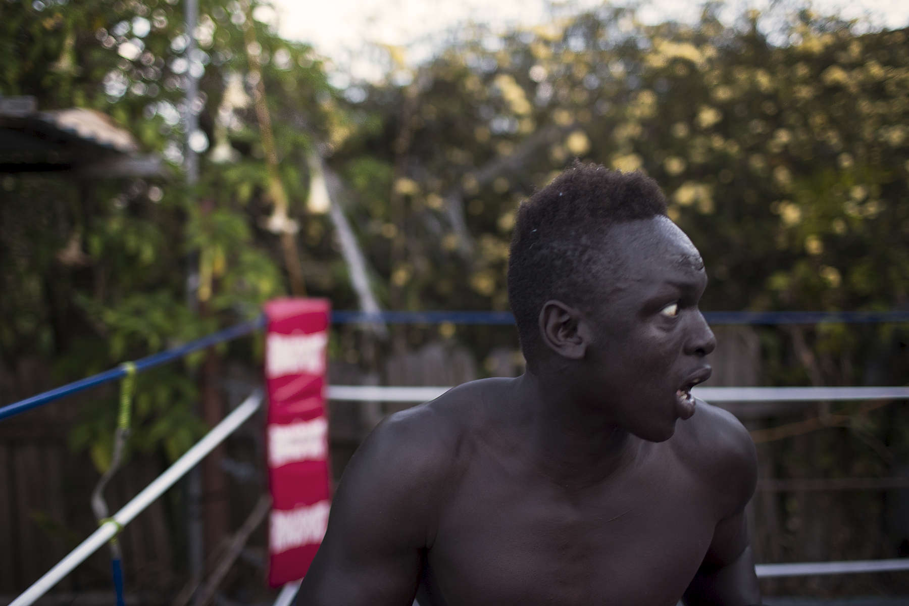 Manyang Dut skips during a training session inside the backyard of local boxer and trainer Daniel Ford (out of picture) in Toronto a lakeside suburb within the city of Lake Macquarie, between Newcastle and Sydney. Manyang, 19 years old, has won a number of national and state amateur boxing belts in recent years and his trainers Shane Wells (left) and Ford think he may be ready to have a shot at professional boxing. Manyang arrived in Australia at 11 years of age in 2005 with his Mother two brothers and three sisters.