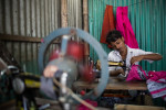 A tailor at work in Korail slum in Dhaka. Korail is one of the oldest slums or boshti as its known in Bangla.