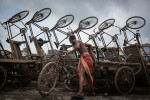 A man pulls out his cycle cart from a line of others along the Buriganga River in Old Dhaka.