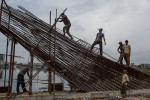 Men working to build a new bridge in an are of Dhaka known as Hatajil.