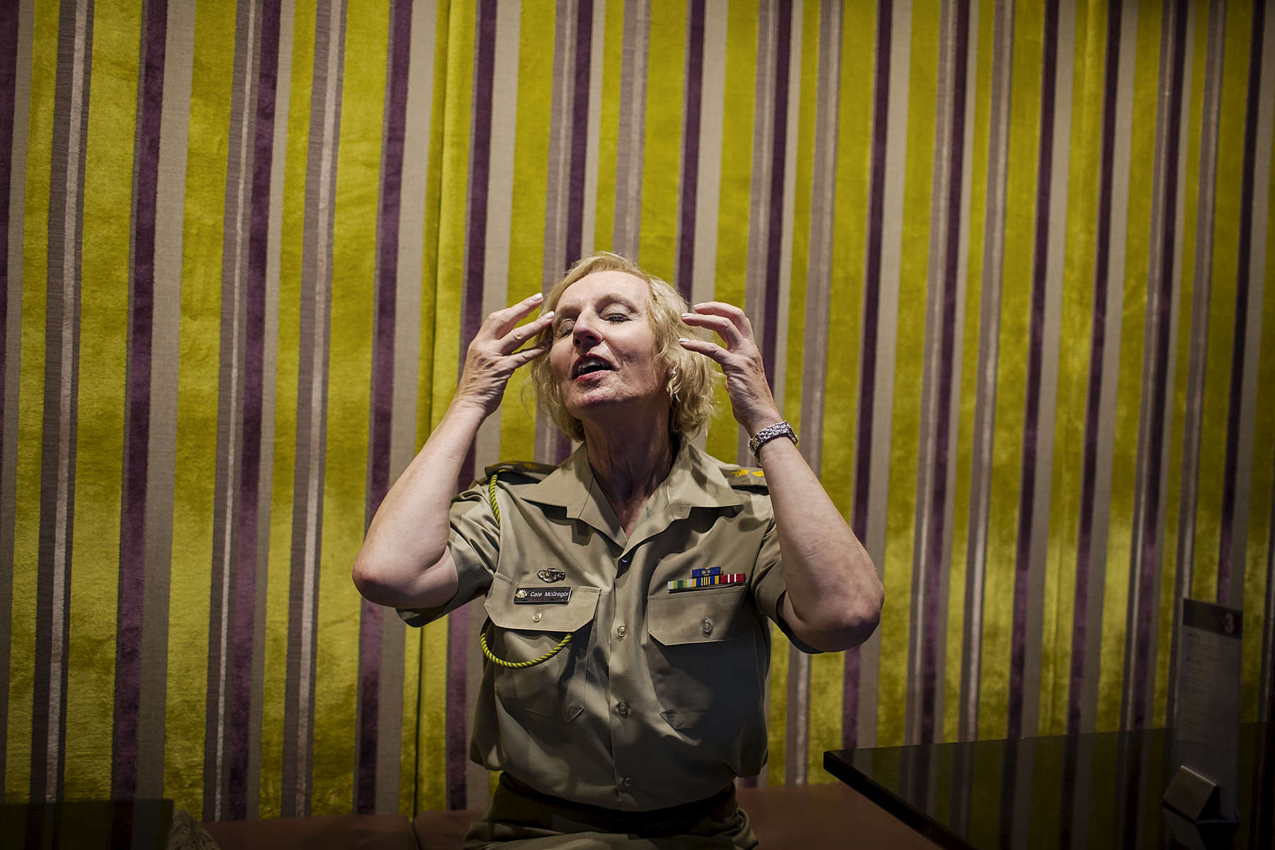 Sydney, NSW, Australia - 02/19/2014: In Martin Place, Sydney CBD, Cate McGregor touches up her hair inside a cafe after coming in from heavy rain. Cate McGregor is the speech writer for the Chief of Australian Army, Lieutenant General David Morrison AO and the most senior transgender military officer in the world.  Conor Ashleigh for the New York Times.