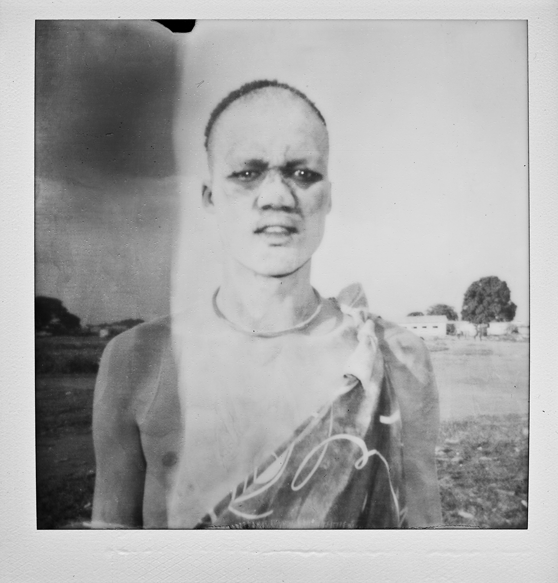 A polaroid of a Mundari goat herder at a livestock market outside Juba, South Sudan. June 2011.