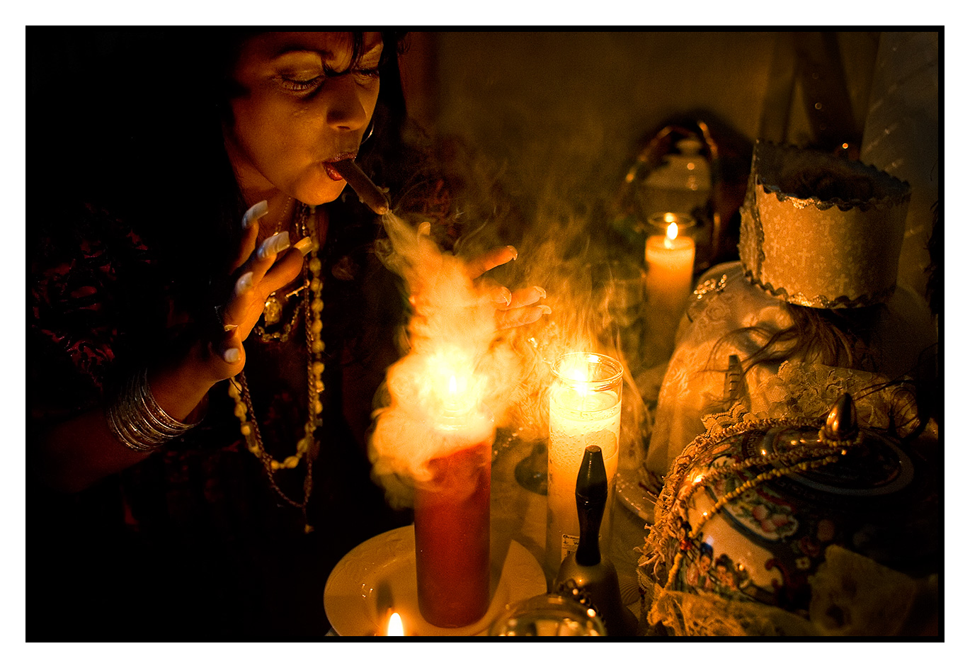 A Santeria Priestess, performs a sacred ceremony to rid evil sprits for a client in her apartment on The Lower East Side of New York