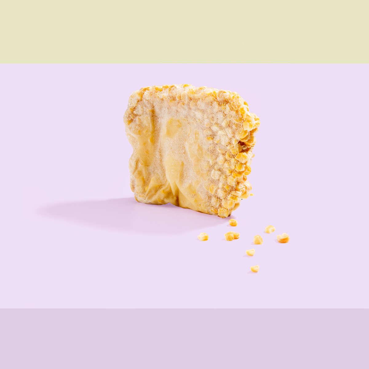 A photograph of frozen block of corn