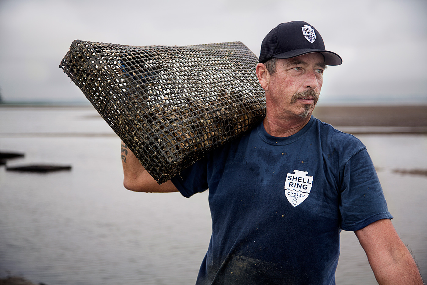 Editorial and portrait photography on location advertising oyster farmers.