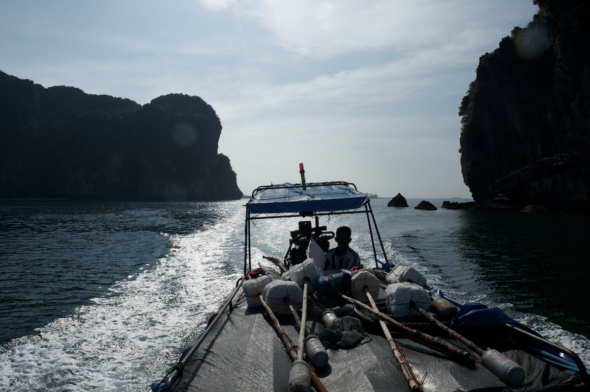 Bang Gii sets out to drop 8 drift nets, an operation he maintains twice a week.
