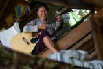 Naw Paw Khu Htee, a medical student at the Free Burma Ranger's Jungle School of Medicine, takes a break from her studies and practices guitar in the women's dormitory.