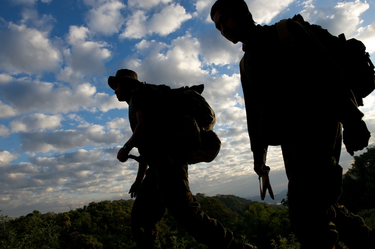 Walking anywhere between a couple hours and several days, team members of the Free Burma Rangers move between villages to provide medical aid in the ethnic states and conflict zones of Burma. Karen State, Burma.