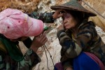 Silver Horn, a member of the Free Burma Rangers examines a women's eye for cataracts.