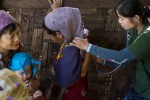 Naw Shah Moo, a student at the Free Burma Ranger Jungle School of Medicine diagnosis a patient at the JSMK outpatient clinic. Common diseases inside Burma include malaria, typhus, diarrhea with dehydration, dysentery, pneumonia, typhoid and minor and major trauma from daily life and the continuing conflict with the Burmese Army.
