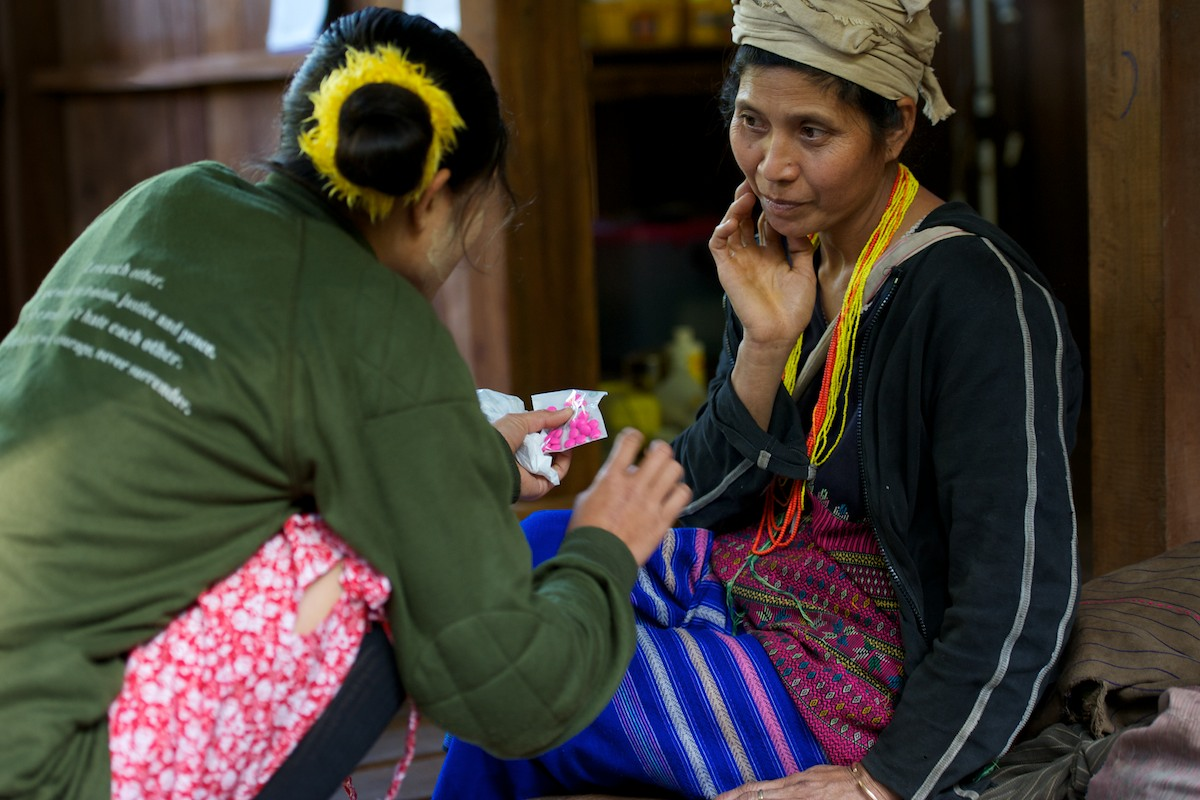 Naw Gay Nya Paw, a medical student, explains a course of antibiotic to a patient at the Free Burma Rangers medical clinic at the Jungle School of Medicine Kawthoolei. Common diseases inside Burma include malaria, typhus, diarrhea with dehydration, dysentery, pneumonia, typhoid and minor and major trauma from daily life and the continuing conflict with the Burmese Army.