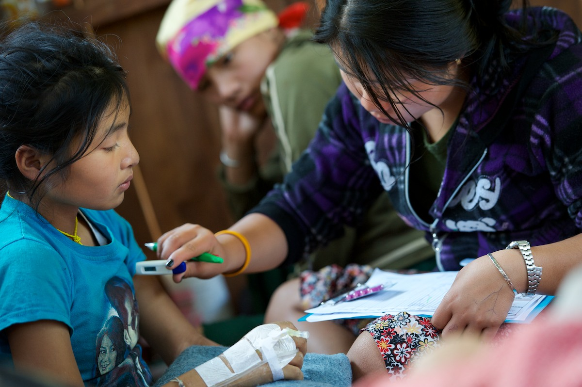 Naw Khu Khu Say, a medical student, checks vital signs of an in-patient at the Free Burma Ranger medical clinic at the Jungle School of Medicine Kawthoolei. This patient was diagnosed with a severe case of staff infection in her left shoulder and left hip, a life threatening infection that was succesfully operated on. Common diseases inside Burma include malaria, typhus, diarrhea with dehydration, dysentery, pneumonia, typhoid and minor and major trauma from daily life and the continuing conflict with the Burmese Army.