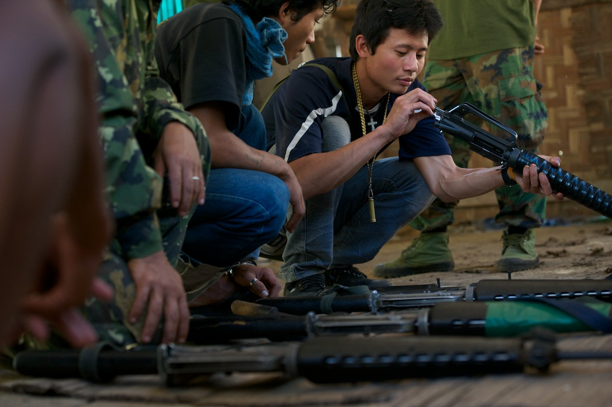 Free Burma Ranger staff and security check and inspect weapons and receive weapon handing training.