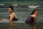 A Laotian mother and daughter take an afternoon bath in the Mekong River.