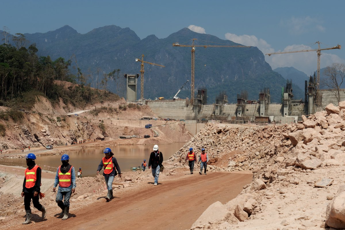 Construction of the Nam Gnounang Dam within the Theun Hinboun Power Company's Nam Theun-Hinboun Hydropower Project in Southern Lao PDR. The Nam Gnounang River flows into the Nam Theun/Nam Kading River system which is one of many major tributary systems on the Mekong River