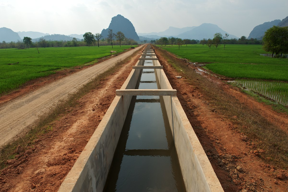 An Theun-Hinboun Power Company irrigation canal carries water from the Nam Hai River to the newly resettled Nongxong village farmland.