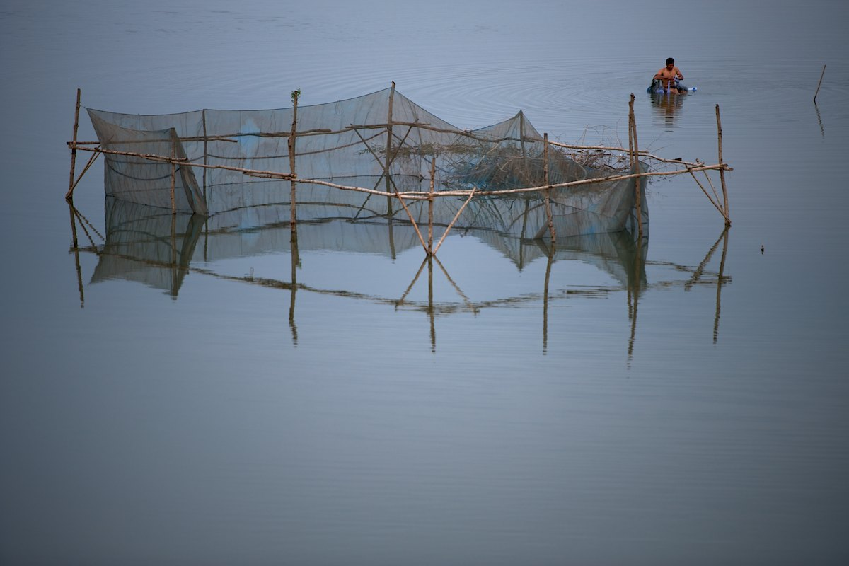 Lae Suprommin, a Thai fisherman, checks his nets every morning fishing for his family.