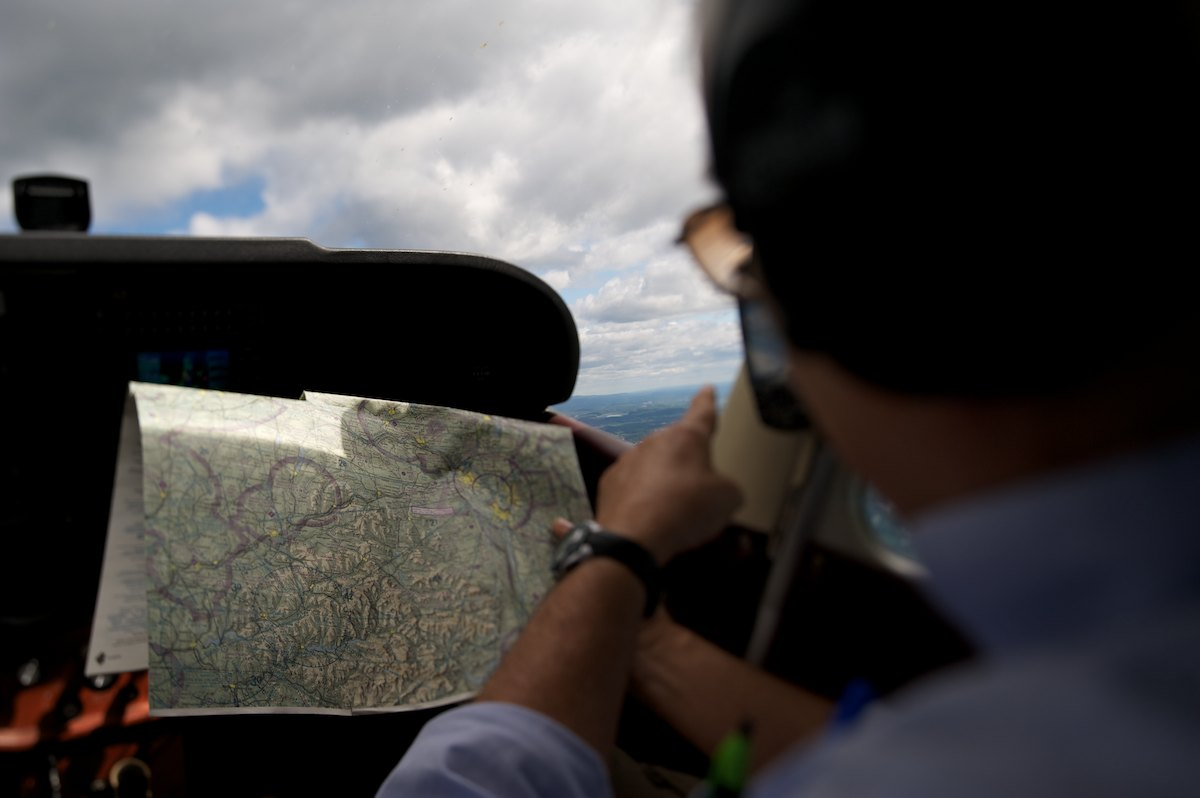 Pilot Al Shultz navigating towards the Schoharie Valley