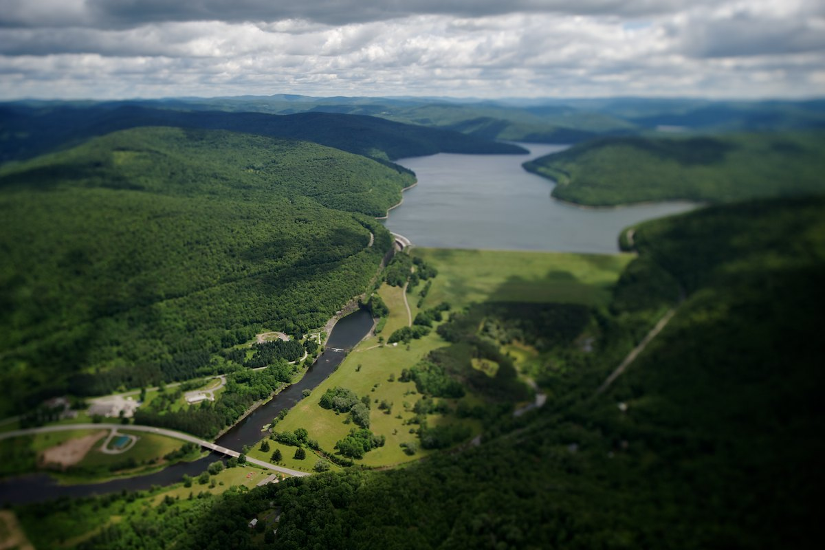 The dam and spillway of the Pepacton Reservoir, Downsville, NY. The Pepacton reservoir holds 140.2 billion gallons at full capacity, which makes it the largest reservoir in the New York City system by volume. Placed into service in 1955.