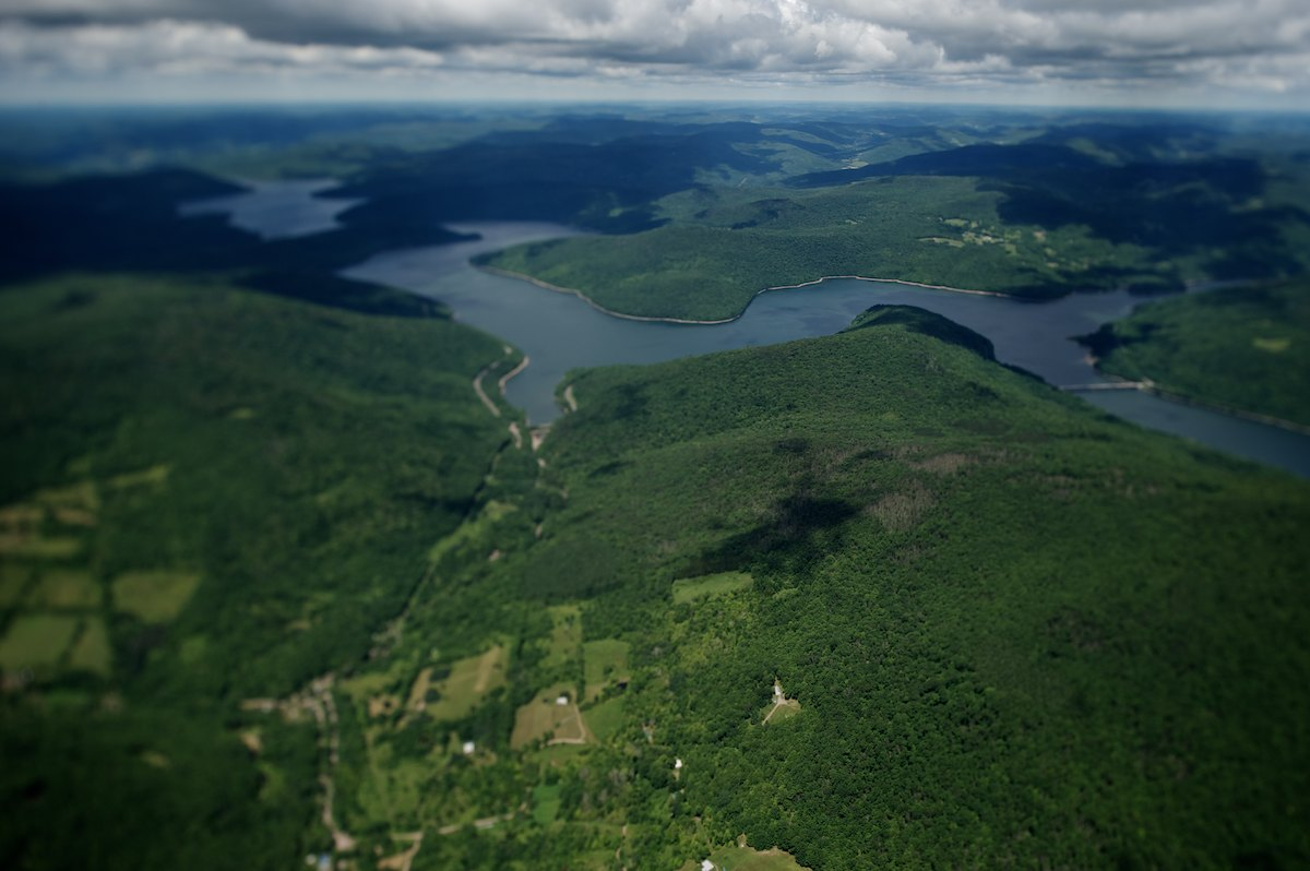 The East end of the Pepacton Reservoir, looking Northwest over Middle Mountain Wild Forest. The Pepacton reservoir holds 140.2 billion gallons at full capacity, which makes it the largest reservoir in the New York City system by volume. Placed into service in 1955.